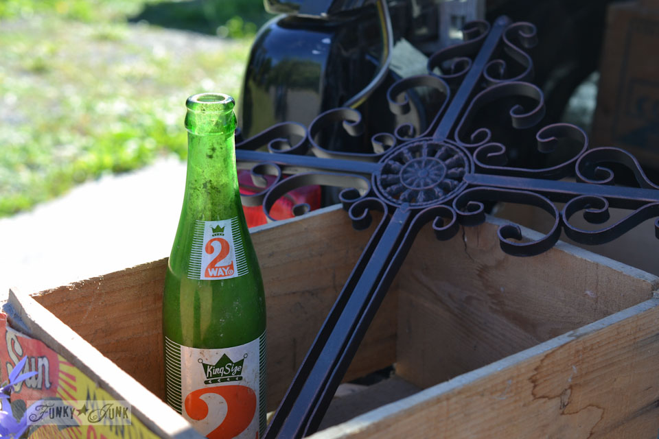 2 Way soda pop bottle, old crate, metal cross - When a junker's junker brother has a garage sale, via Funky Junk Interiors