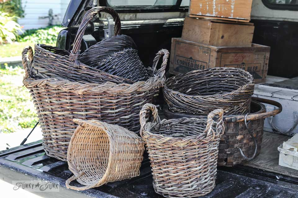 Rustic baskets with hooks - When a junker's junker brother has a garage sale, via Funky Junk Interiors