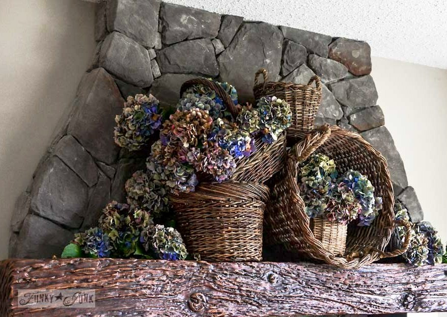 Hydrangea filled rustic baskets for a fall mantel - with cats. via https://www.funkyjunkinteriors.net