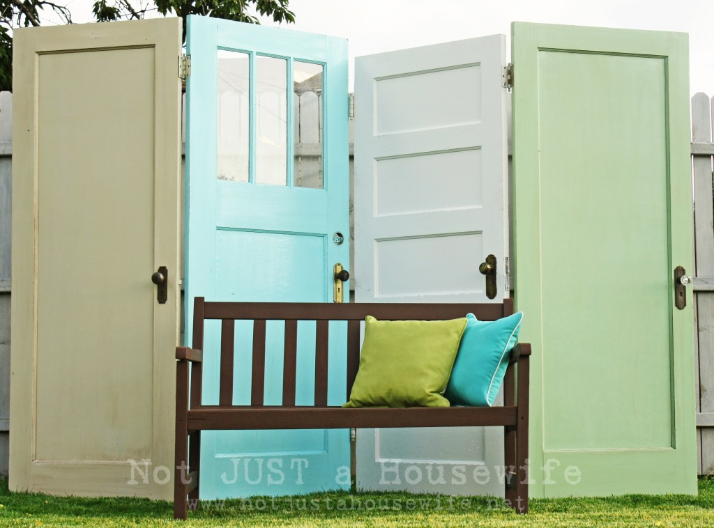 Old door outdoor privacy screen for the yard, by Not JUST A Housewife, featured on https://www.funkyjunkinteriors.net/