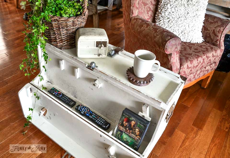 From toolbox to side table on wheels with hidden storage via http://www.funkyjunkinteriors.net/