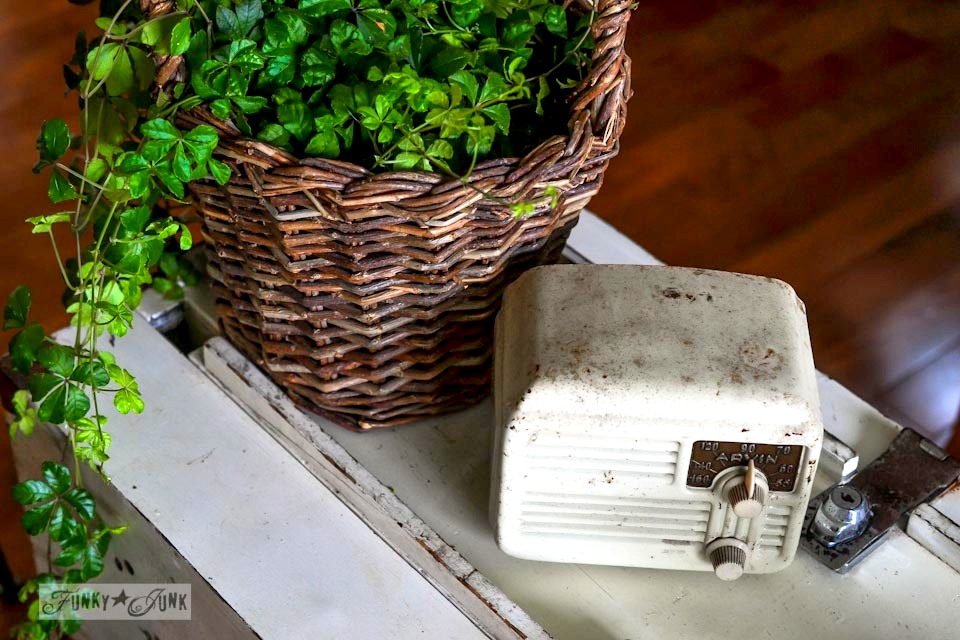 Vintage radio and wicker basket with plant vignette / part of a funky tool box side table with hidden junk storage / via https://www.funkyjunkinteriors.net/