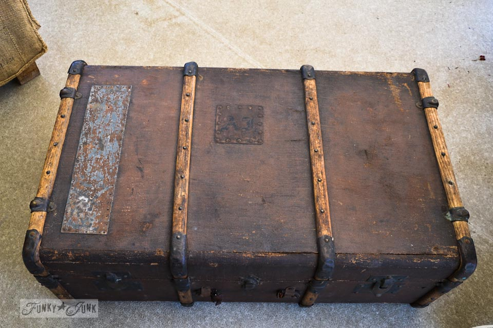 An old trunk with wood strappings, part of / A funky old trunk and bean sack ottoman on wheels, with a burlap pillowcase... super cool AND easy to make via : https://www.funkyjunkinteriors.net/
