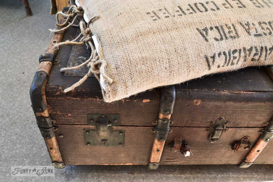 A funky old trunk and bean sack ottoman on wheels, with a burlap pillowcase... super cool AND easy to make via : https://www.funkyjunkinteriors.net/