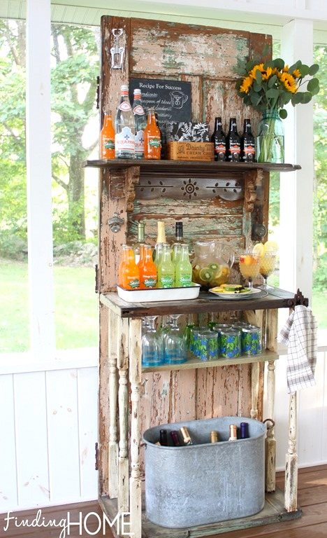 Vintage old door outdoor beverage station by Finding Home featured on https://www.funkyjunkinteriors.net/