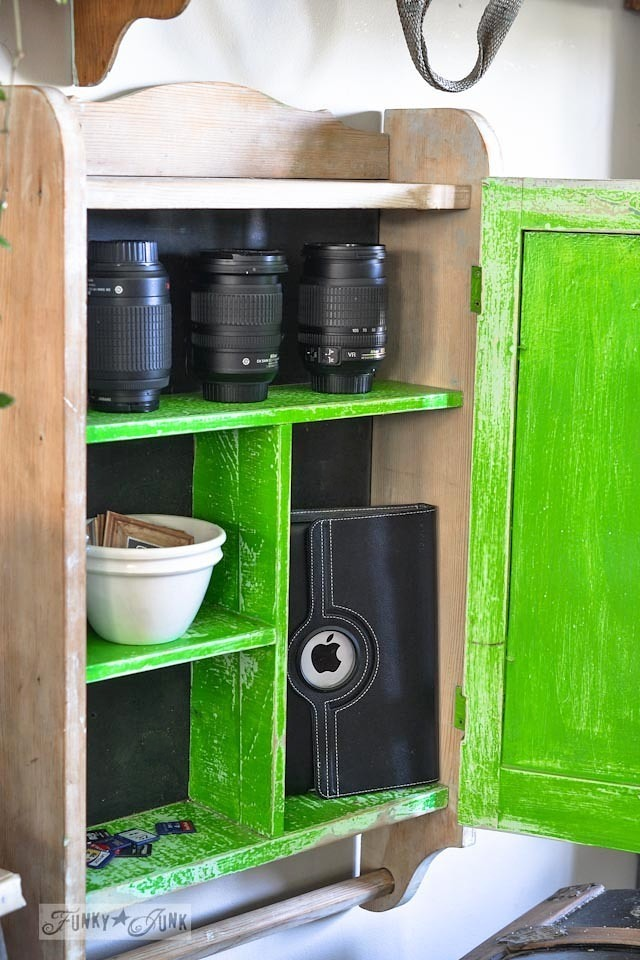 Bright green and black cabinet for camera lens and iPad storage - part of a funky wall cabinet gallery reveal via : https://www.funkyjunkinteriors.net/