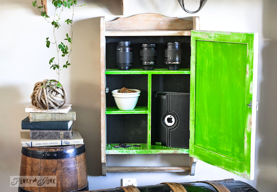 Wall cabinet shelving for camera lenses via https://www.funkyjunkinteriors.net/