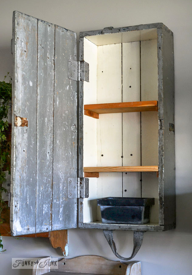 Old crate with shelves for wall storage - part of a funky wall cabinet gallery reveal via : https://www.funkyjunkinteriors.net/