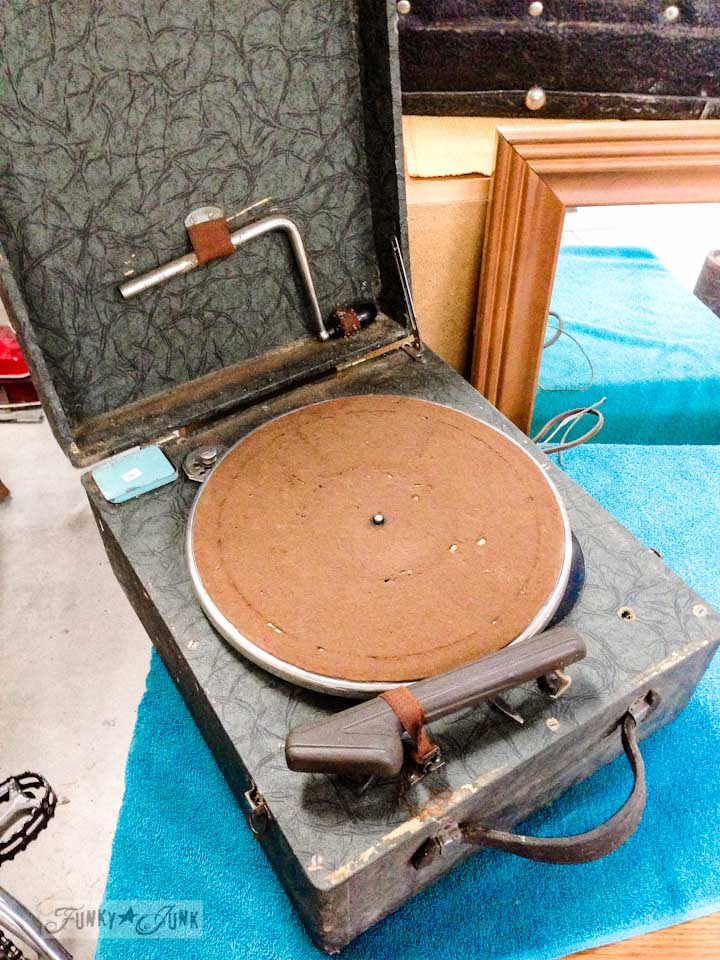Old record player with felt turn table at a dreamy garage sale in a dream shop