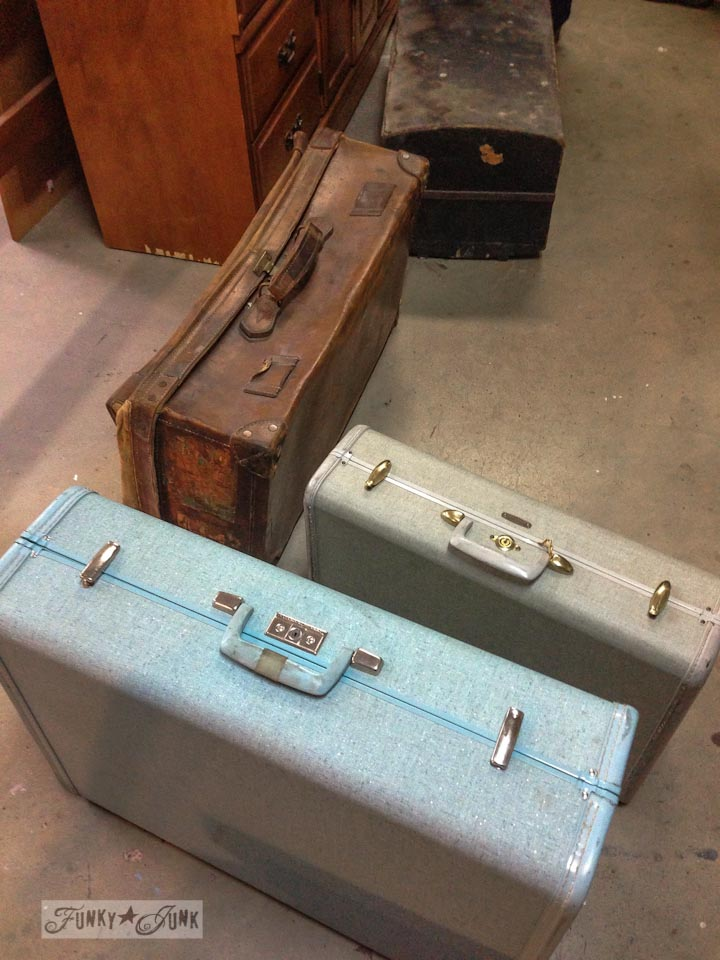 Vintage suitcase collection at a dreamy garage sale in a dream shop