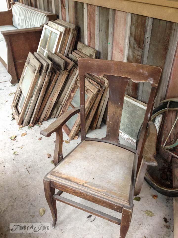 Old windows and chairs at a dreamy garage sale in a dream shop