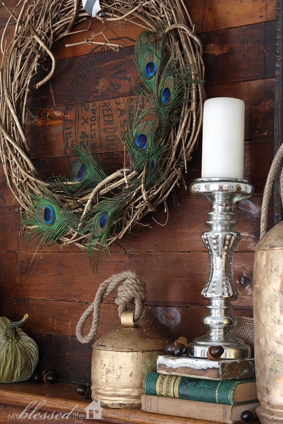 Peacock feather wreath / part of Layered Glam Fall Mantel by My Blessed Life, featured on http://www.funkyjunkinteriors.net/