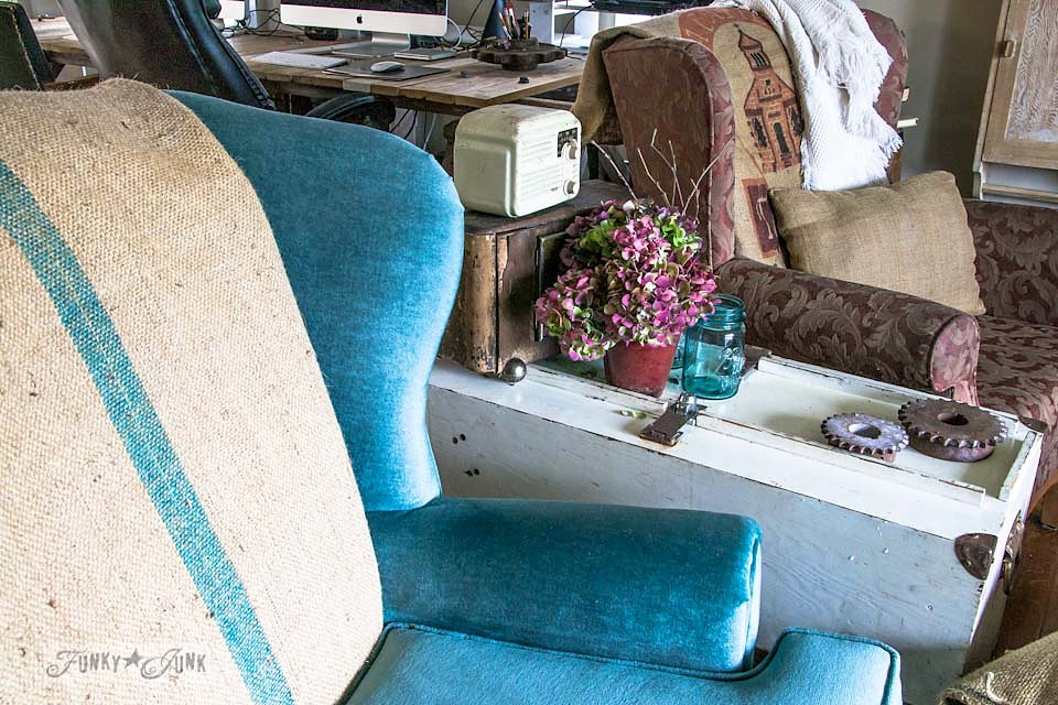 Burlap coffee bean bags on wing chairs  / part of Playing with fall hydrangeas and a (very) blue chair via https://www.funkyjunkinteriors.net/