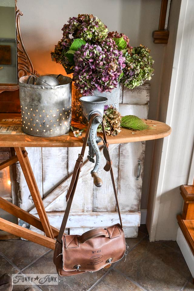 Illuminated minnow buckets and meat grinder for purse hanger / Fall junkers unite with an ironing board table, a pin board and a linkup! via https://www.funkyjunkinteriors.net/