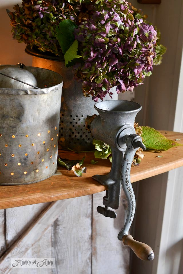 Illuminated minnow buckets and meat grinder  / Fall junkers unite with an ironing board table, a pin board and a linkup! via https://www.funkyjunkinteriors.net/