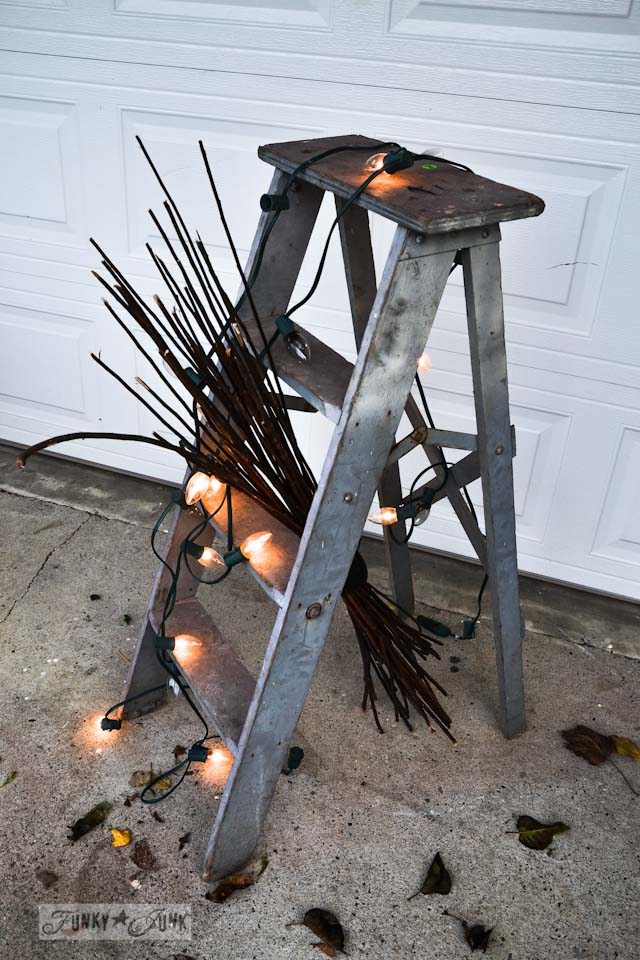 ladder and Christmas lights  / Happy cheater Halloween decorating! No carving required. via https://www.funkyjunkinteriors.net/