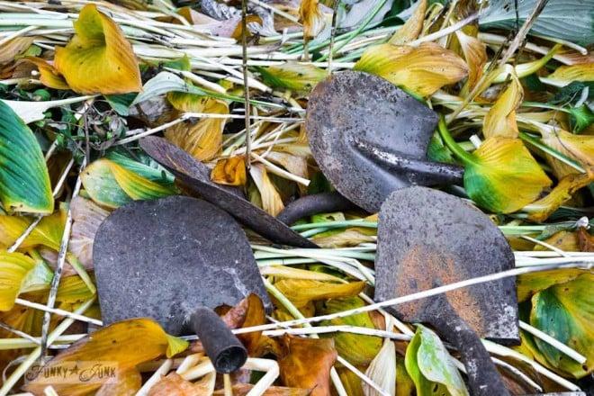 rusty shovel heads in fall leaves via https://www.funkyjunkinteriors.net/