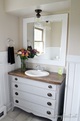 Oak topped dresser bathroom vanity by Beneath My Heart, featured on https://www.funkyjunkinteriors.net/