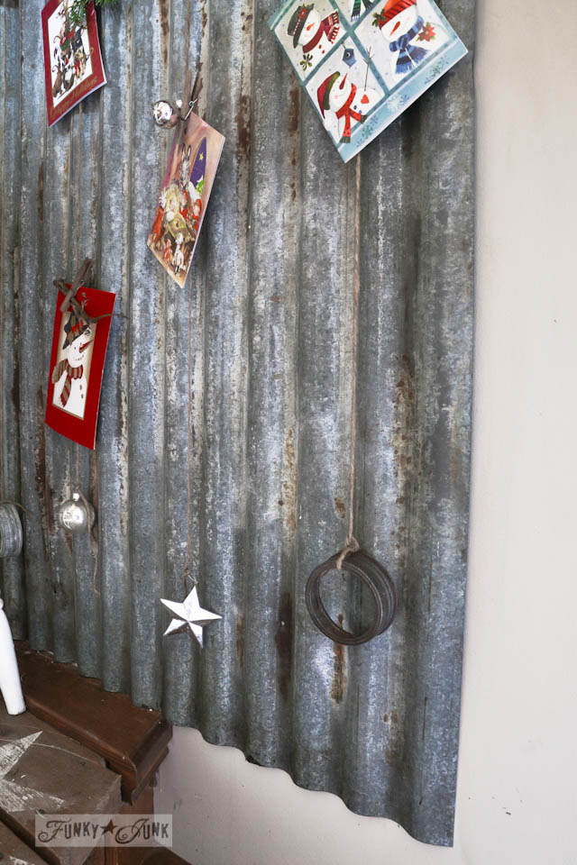 Metal siding Christmas card holder / Funky Junk Interiors Christmas Home Tour 2013 via https://www.funkyjunkinteriors.net/