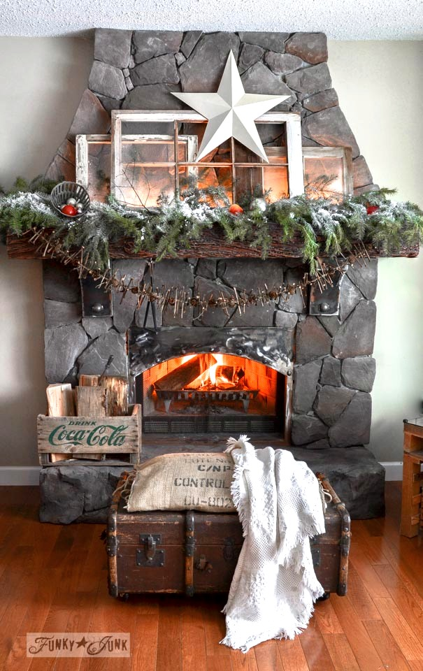 Christmas fireplace mantel with old windows and garland on FunkyJunkInteriors.net