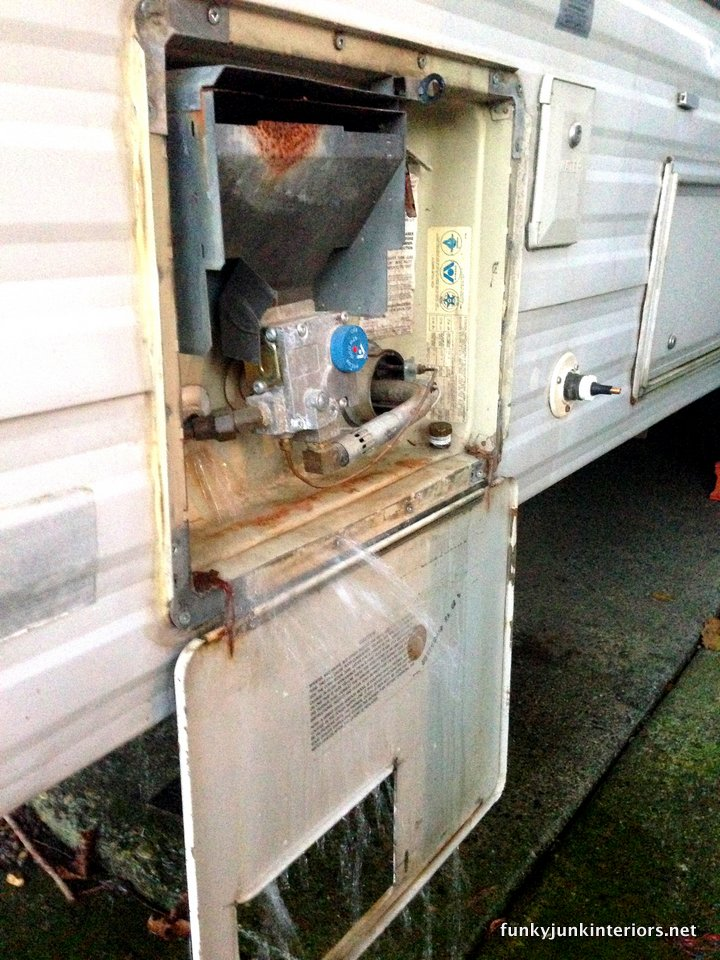 Draining the rv hot water tank / How to winterize an rv by blowing out the lines. No messy antifreeze in your drinking water! via https://www.funkyjunkinteriors.net/
