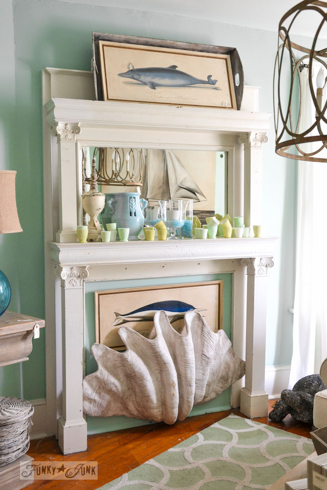 White vintage fireplace with giant seashell  / 9 - A tour of Lucketts Design House via https://www.funkyjunkinteriors.net/