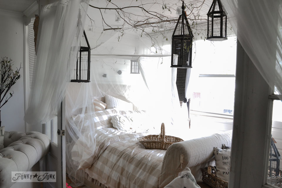 A whimsical garden inspired bedroom with sheers, branches and lanterns  / 9 - A tour of Lucketts Design House via https://www.funkyjunkinteriors.net/