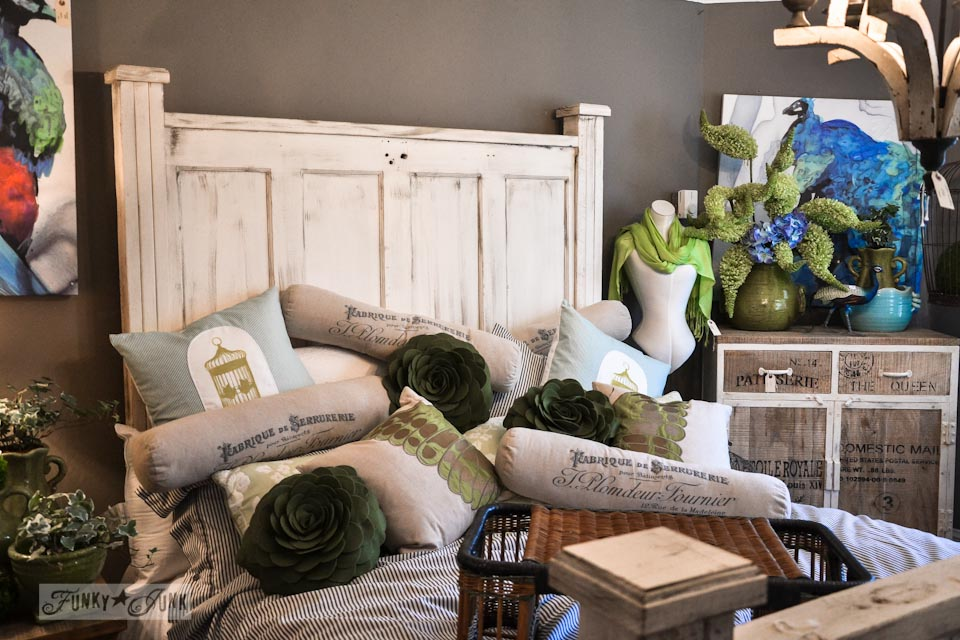 Door styled headboard buried with amazing throw pillows / 9 - A tour of Lucketts Design House via https://www.funkyjunkinteriors.net/