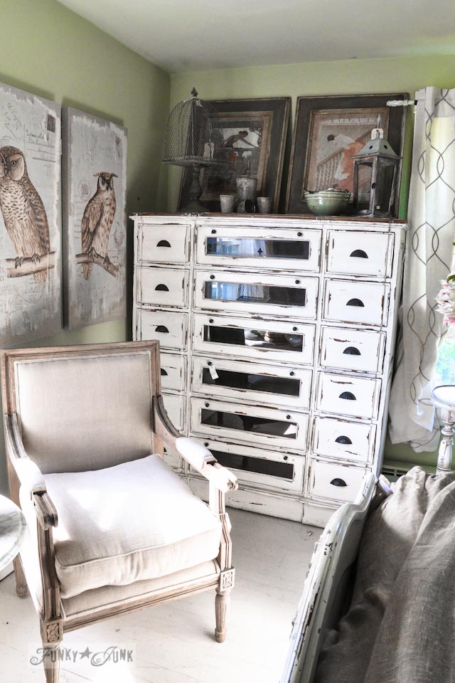 Tall white dresser with window fronts  / 9 - A tour of Lucketts Design House via https://www.funkyjunkinteriors.net/