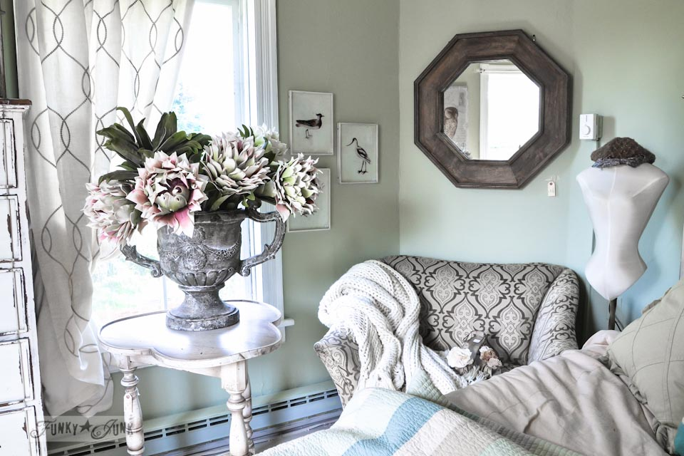 Trophy styled urn for flowers with hexagon wooden mirror  / 9 - A tour of Lucketts Design House via https://www.funkyjunkinteriors.net/