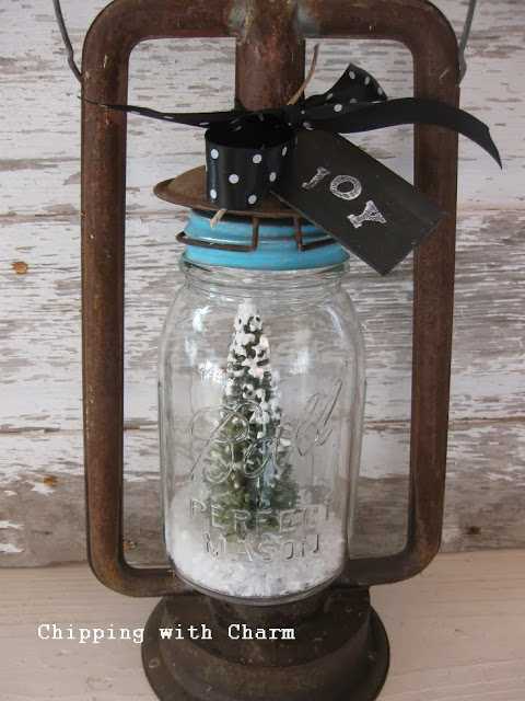 Snow globe lantern Christmas Tree, by Chipping with Charm, featured on https://www.funkyjunkinteriors.net/