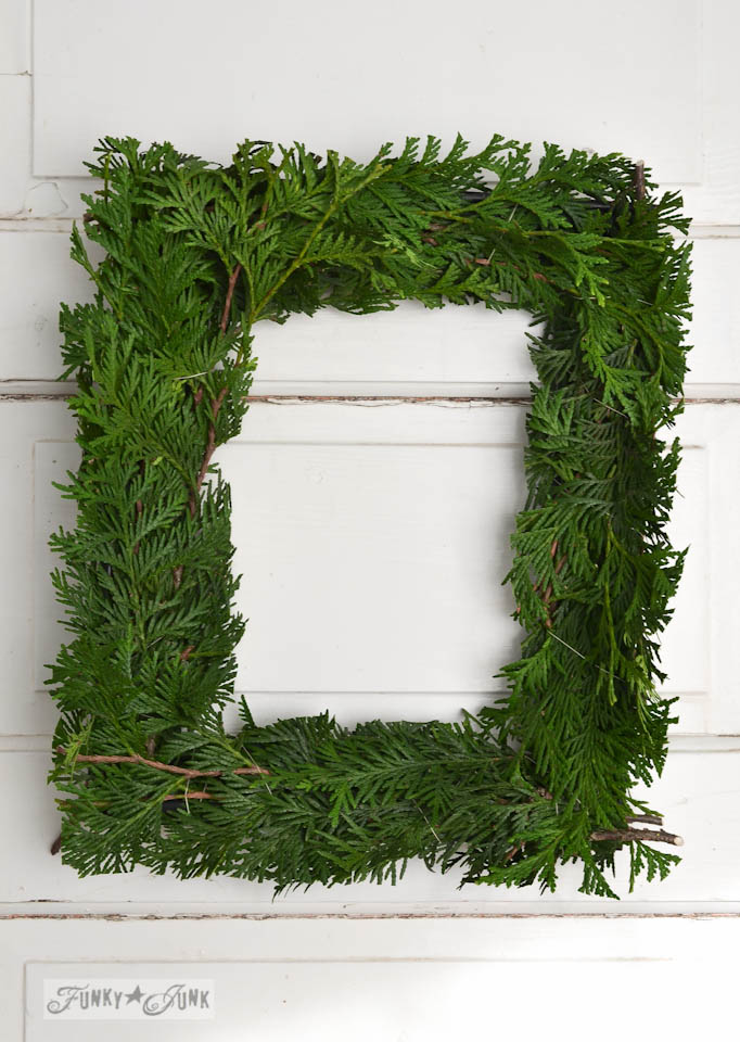 Square evergreen wreath / How to make a square evergreen wreath on a picture frame. So easy!  via https://www.funkyjunkinteriors.net/