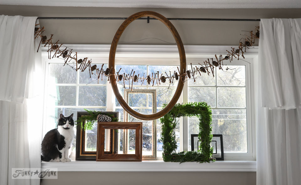 Square evergreen wreath and twig garland with tuxedo cat / When Cats Photobomb via FunkyJunkInteriors