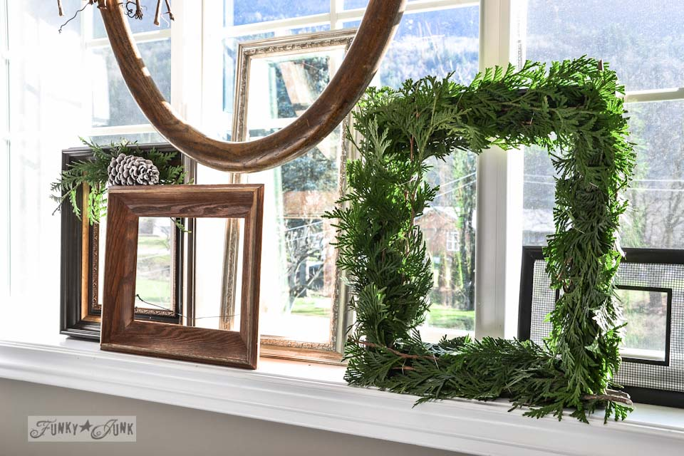 Evergreen frame wreath on windowsill / Funky Junk Interiors Christmas Home Tour 2013 via https://www.funkyjunkinteriors.net/