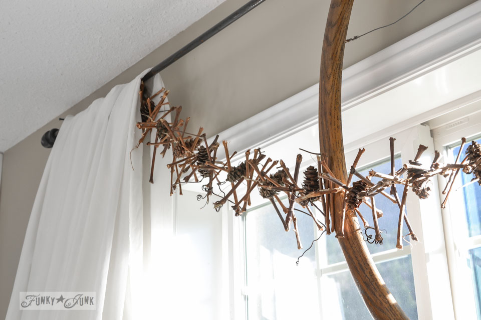 grapevine twig and pinecone garland / How to make a square evergreen wreath on a picture frame. So easy!  via https://www.funkyjunkinteriors.net/