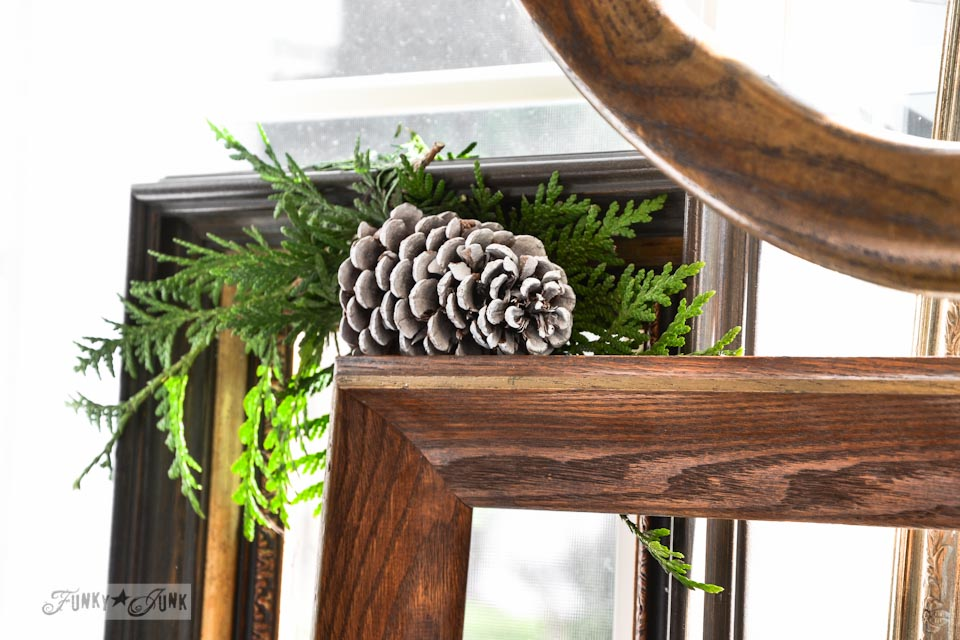 Evergreen spray with pinecone / How to make a square evergreen wreath on a picture frame. So easy!  via https://www.funkyjunkinteriors.net/