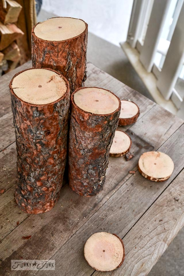 Cutting the logs / Nature inspired Christmas log candle centrepiece, via https://www.funkyjunkinteriors.net/