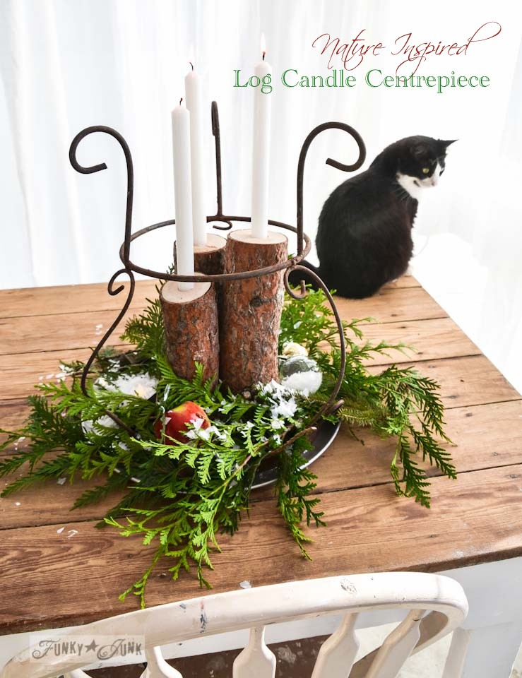 Nature inspired Christmas log candle centrepiece, via https://www.funkyjunkinteriors.net/