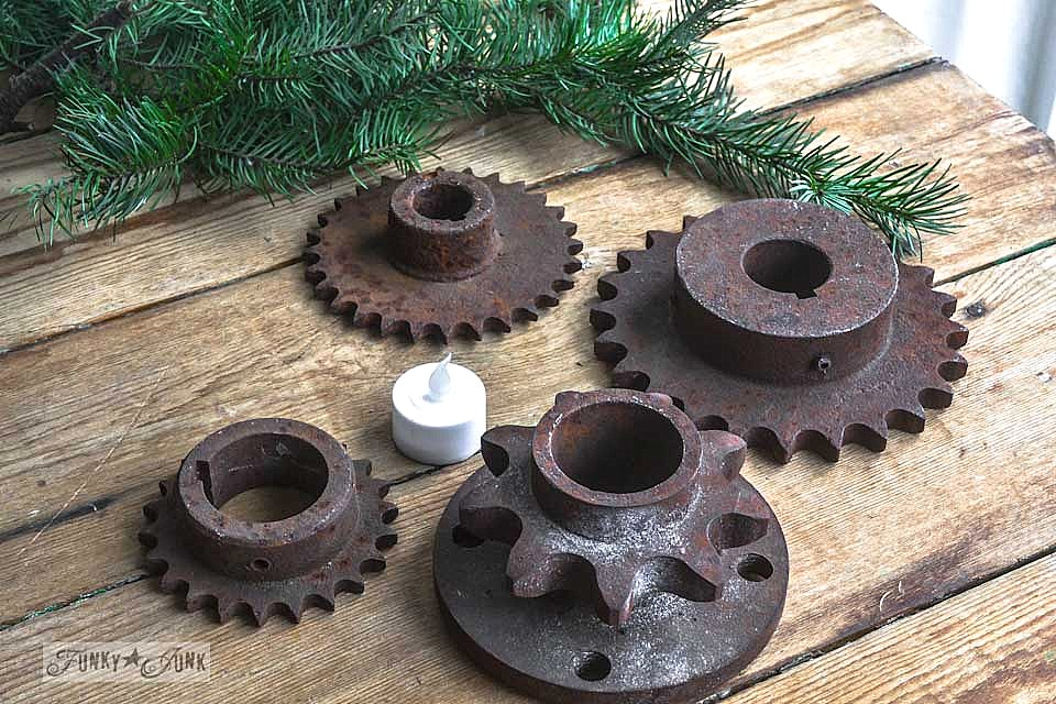 A collection of rusty gears / Stacked gear Christmas tree tea lights