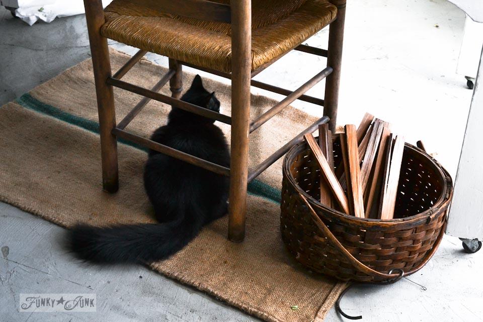 Cat under chair on burlap sack / part of Santa's junk workshop and cat elves in full swing! via https://www.funkyjunkinteriors.net/