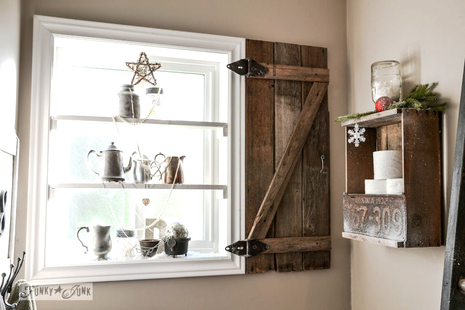 Wooden window shutter and old crate toilet paper storage / Silver bling Christmas tree window shelves via https://www.funkyjunkinteriors.net/