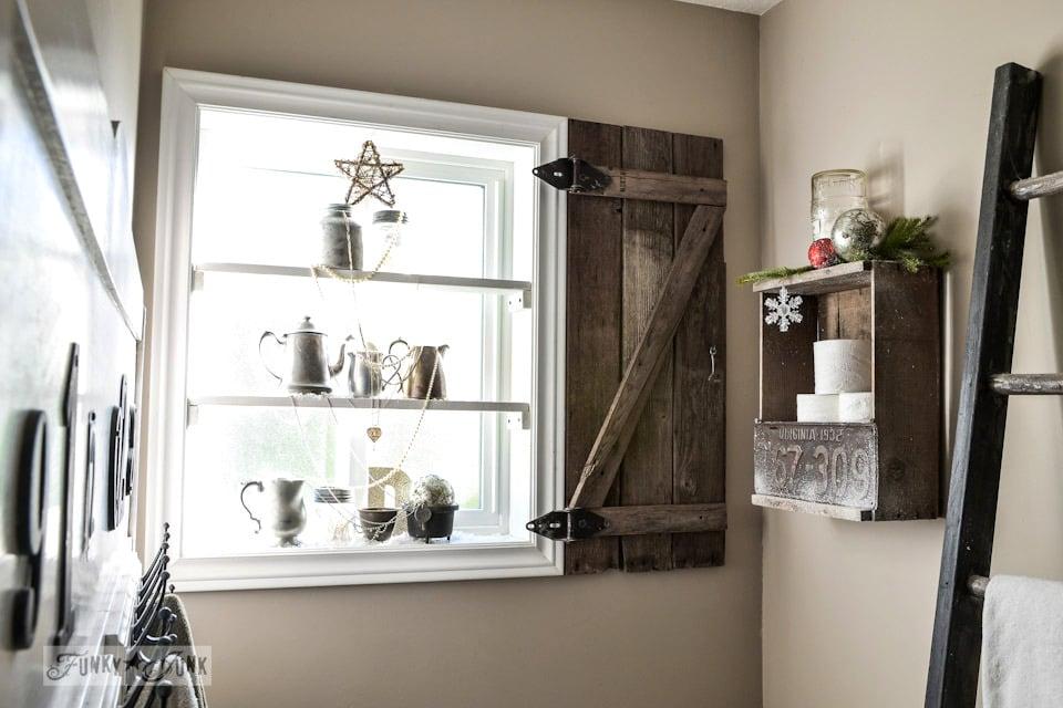 A winter bathroom / Silver bling Christmas tree window shelves via https://www.funkyjunkinteriors.net/