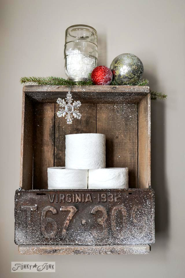 Old crate and license plate toilet paper storage with faux snow / Funky Junk Interiors Christmas Home Tour 2013 via https://www.funkyjunkinteriors.net/