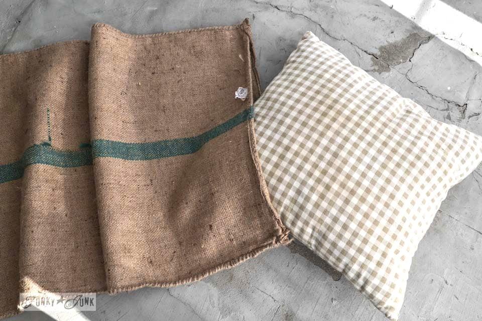 Slipping a pillow into a coffee bean bag / No sew burlap coffee bean sack sofa pillows... instantly! via https://www.funkyjunkinteriors.net/