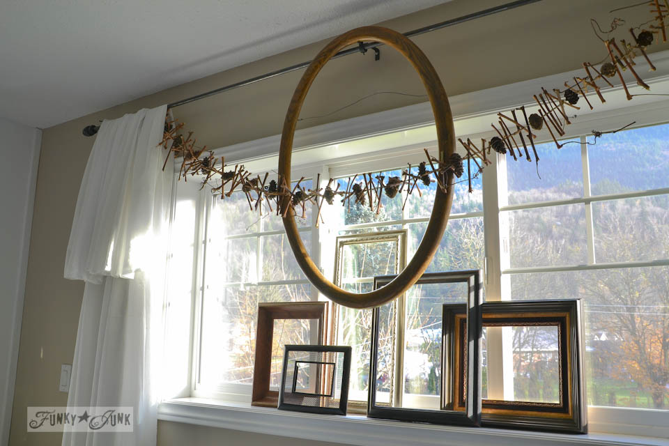 Empty frames in a window / Make an all season twig pinecone garland for free! And in under 2 hours! via https://www.funkyjunkinteriors.net/