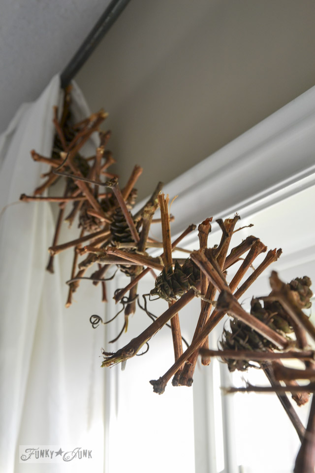 Create a grapevine pinecone garland in under 2 hours! via http://www.funkyjunkinteriors.net/