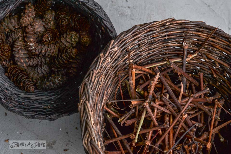 Gathering grapevine twigs and pinecones for a rustic garland for Christmas via https://www.funkyjunkinteriors.net/