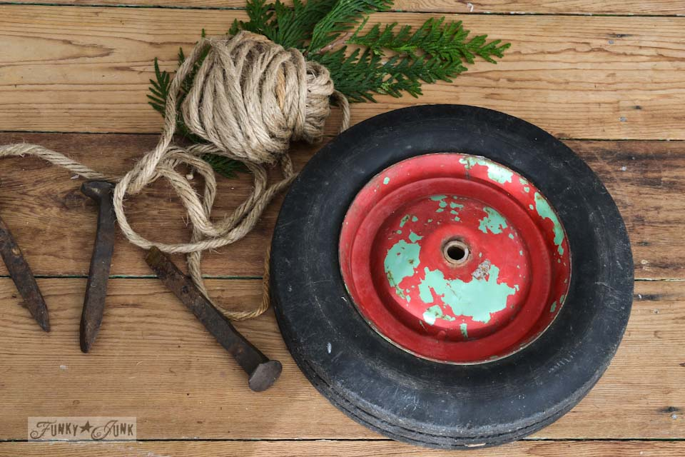 red and green chippy wheel and heavy twine /  Junk wheel Christmas wreaths via http://www.funkyjunkinteriors.net/