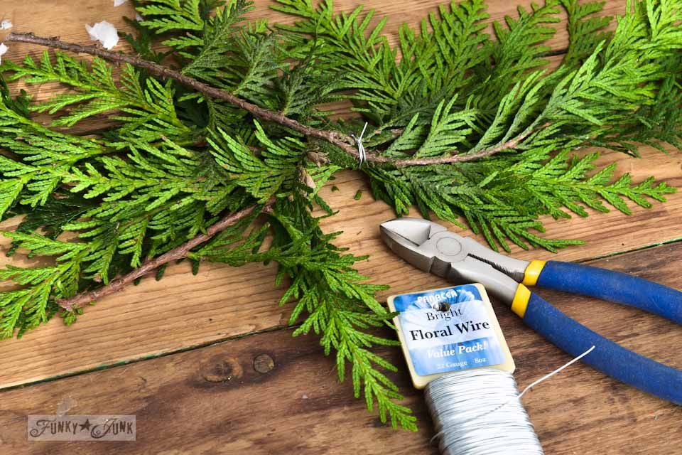 Creating an evergreen spray / How to make a square evergreen wreath on a picture frame. So easy!  via https://www.funkyjunkinteriors.net/