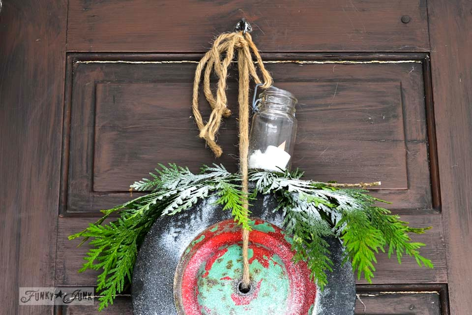 Wheel wreath with candle / How to shop nature for Christmas decorating... where to find it and what to do with it  via https://www.funkyjunkinteriors.net/
